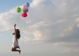 mujer triunfo exito globos